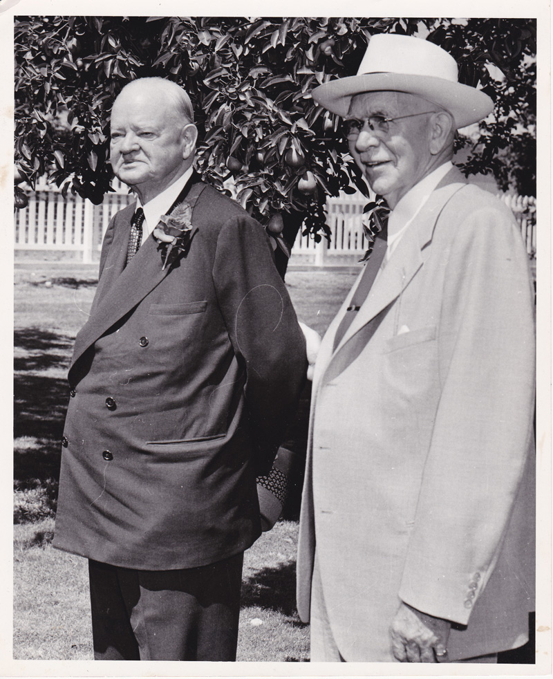 Herbert Hoover with his boyhood friend Burt Brown Barker by the pear tree. Photo by Les Ordeman, courtesy of The Oregonian