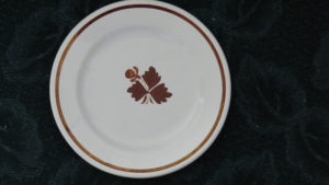 Royal Ironstone plate in Tea Leaf pattern; the Minthorns used this pattern