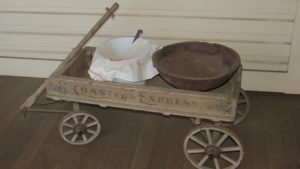 Wood Coaster Express wagon with a covered water pail and a wood bowl
