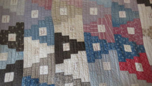 Friendship quilt with names embroidered in squares