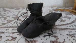 Pair of small black leather boots for a child